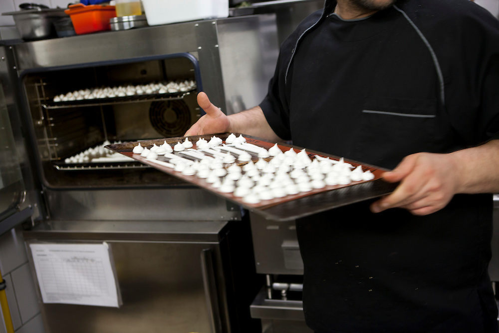 Mini homemade meringues are taken out of the oven in the kitchen of restaurant 'Flaveur', Nice, France, 10 April 2012
