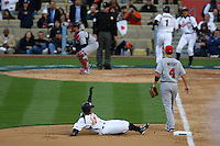 Akinori Iwamura of Japan slides into third base covered by David Wright of the United States during a game at the World Baseball Classic at Dodger Stadium on March 22, 2009 in Los Angeles, California. (Larry Goren/Four Seam Images)