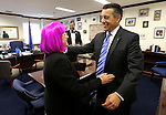Gov. Brian Sandoval congratulates Sens. Debbie Smith, D-Sparks, and Aaron Ford, D-Las Vegas, following passage of Sandoval's $1.1 billion tax package at the Legislative Building in Carson City, Nev., on Monday, June 1, 2015. <br />