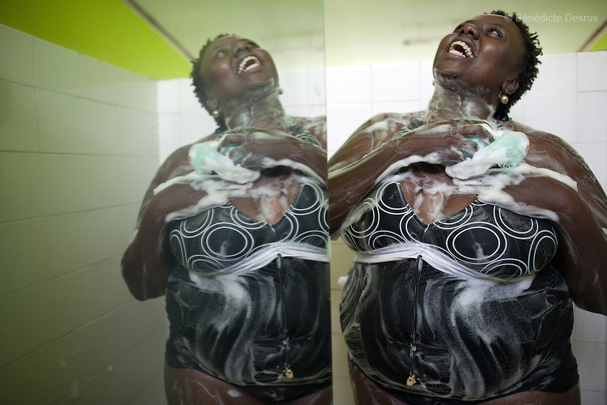 "Ruth Gathu takes a shower after a swimming workouts session with Alice Ojwang-Ndong, her nutritionist and dietetic consultant in Nairobi, Kenya on December 11, 2012. Ruth Gathu is a 35 year-old Kenyan woman who works as an office administrator. She weighs 299 pounds and weighs 175 centimeters, with a BMI of 44.3. She says: ""In Kenya, people don't spend money on nutrition programs""…""Obesity is in all the social class in Kenya, the rich, the middle class and the poor."" Nairobi has a high prevalence of overweight and obesity among women, especially those in the middle and upper class. Like elsewhere in the world, the main drivers of obesity in Kenya are rapid urbanization and westernization, that have resulted in changing lifestyles such as increased consumption of ""unhealthy diets"" and adoption of sedentary lifestyles. Photo by Bénédicte Desrus"