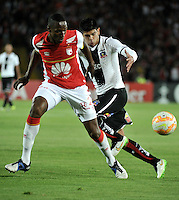 BOGOTA- COLOMBIA – 26-02-2015: Yerry Mina (Izq.) jugador del Independiente Santa Fe de Colombia, disputa el balón con Felipe Flores (Der.) jugador de Colo Colo de Chile, durante partido entre Independiente Santa Fe de Colombia y Colo Colo de Chile, por la segunda fase, grupo 1, de la Copa Bridgestone Libertadores en el estadio Nemesio Camacho El Campin, de la ciudad de Bogota. / Yerry Mina (L) player of Independiente Santa Fe of Colombia, figths for the ball with Felipe Flores (R) player of Colo Colo of Chile during a match between Independiente Santa Fe of Colombia and Colo Colo of Chile for the second phase, group 1, of the Copa Bridgestone Libertadores in the Nemesio Camacho El Campin in Bogota city. Photo: VizzorImage / Luis Ramirez / Staff.
