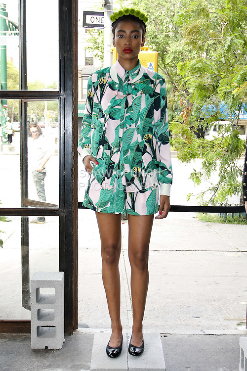 Model poses in an outfit from the Mia Moretti x Pencey Spring Summer 2013 fashion collection presentation by DJ Mia moretti and Christina Minasian during New York Fashion Week, September 6, 2012