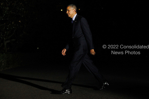United States President Barack Obama returns from campaign events in Texas, to the White House in Washington, D.C., U.S., on Wednesday, July 18, 2012.  .Credit: Jonathan Ernst / Pool via CNP