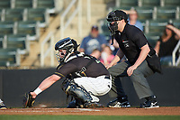 Kannapolis Intimidators catcher Evan Skoug (11) reaches for a low pitch as home plate umpire Forrest Ladd looks on during the game against the Hagerstown Suns at Kannapolis Intimidators Stadium on May 4, 2018 in Kannapolis, North Carolina.  The Intimidators defeated the Suns 11-0.  (Brian Westerholt/Four Seam Images)