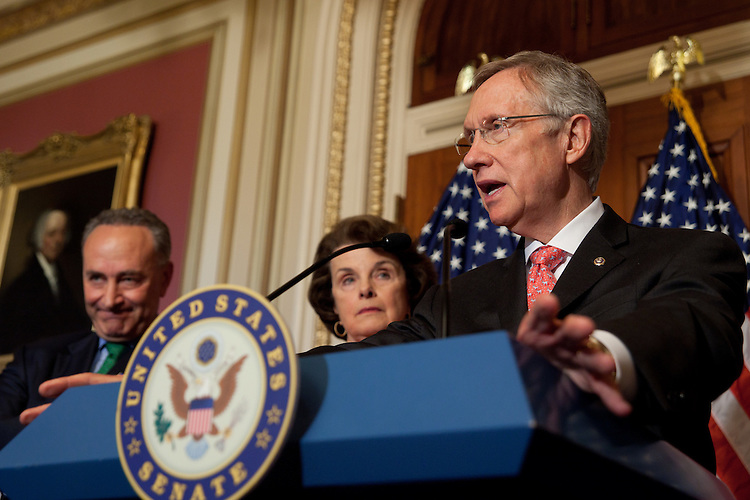 WASHINGTON, DC - April 29: Senate Majority Leader Harry Reid (D-Nev.) speaks during the unveiling of an immigration reform outline. Conference Vice Chairman Charles E. Schumer (D-N.Y.) and Senator Dianne Feinstein (D-Calif) look on. (Photo by Ryan Kelly/Congressional Quarterly)