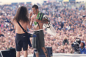 Pantera - guitarist Dimebag Darrell Abbott and vocalist Phil Anselmo performing live on the main stage at the Monsters of Rock held at Donington Park UK - 04 Jun 1994.  Photo credit: Eddie Malluk/IconicPix