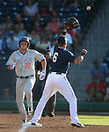 Reno Aces' first baseman Mike Jacobs makes the out against Las Vegas 51s' Matt den Dekker during a Triple-A baseball game in Reno, Nev., on Sunday, July 21, 2013. The 51s won 15-8.<br /> Photo by Cathleen Allison