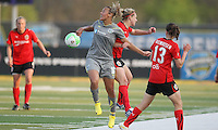 Independence forward, Lianne Sanderson (10), collides with Atlanta defender, Lauren Sesselmann (14), as they vie for a header.  Atlanta and Philadelphia played to a 0-0 draw in the season opener for both teams at John A Farrell Stadium in West Chester, PA.