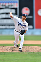 Asheville Tourists pitcher Heath Holder (26) delivers a pitch during a game against the Rome Braves at McCormick Field on June 25, 2017 in Asheville, North Carolina. The Braves defeated the Tourists 7-2. (Tony Farlow/Four Seam Images)