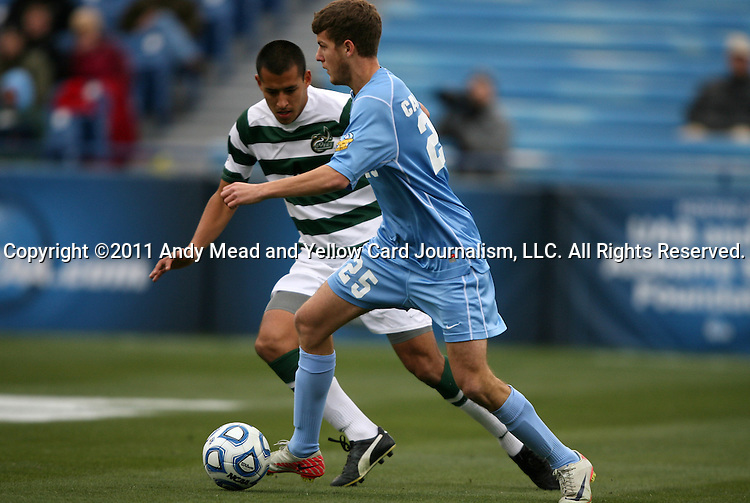 11 December 2011: North Carolina's Rob Lovejoy (25) and UNCC's Charles Rodriguez (behind). The University of North Carolina Tar Heels defeated the University of North Carolina Charlotte 49ers 1-0 at Regions Park in Hoover, Alabama in the NCAA Division I Men's Soccer College Cup Final.