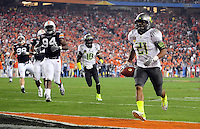 Jan 10, 2011; Glendale, AZ, USA; Oregon Ducks running back LaMichael James (21) scores a touchdown during the second quarter of the 2011 BCS National Championship game against the Auburn Tigers at University of Phoenix Stadium.  Mandatory Credit: Mark J. Rebilas-