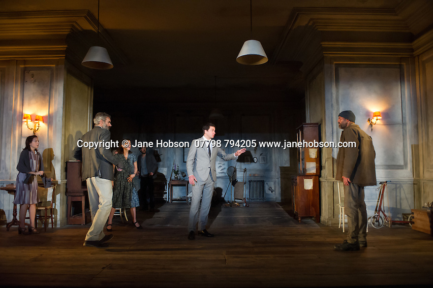 London, UK. 15.10.2014. The Young Vic presents Chekhov's THE CHERRY ORCHARD, directed by Katie Mitchell. Picture shows: Catrin Stewart (Anya), Angus Wright (Leonid Gaev), Natalie Klamar (Varya), Paul Hilton (Peter Trofimov), Dominic Rowan (Alexander Lopakhin) and Andy Cresswell (Wanderer). Photograph © Jane Hobson.