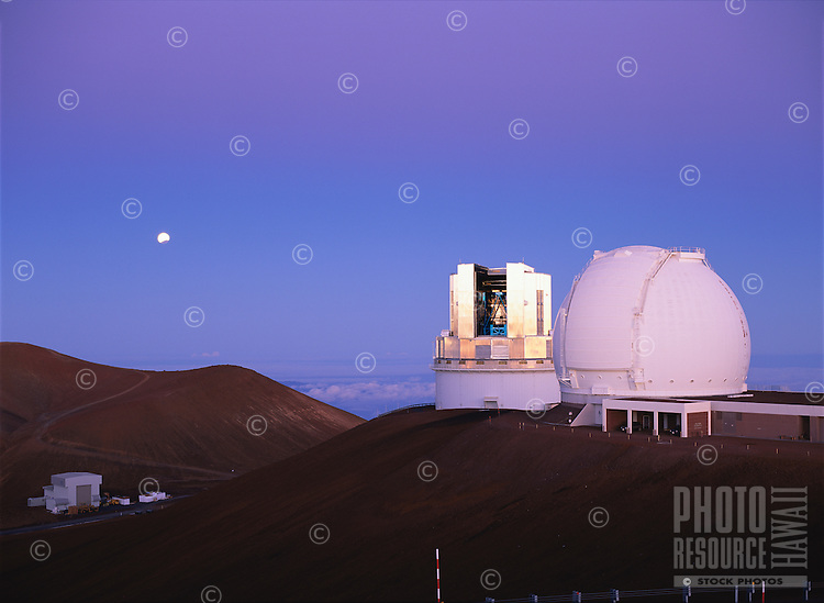 Keck 1 Telescope (right), Subaru Telescope (center), and partially eclipsed moon (left).  Photo taken during morning twilight, shortly after a total lunar eclipse.  Mauna Kea Observatory, Hawaii.