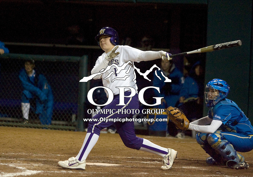 1 April 2010:  Washington Huskies catcher #1 Shawna Wright fouls off a seventh inning pitch just down the left field foul pole line against UCLA. UCLA defeated Washington 1-0 at Husky Softball Stadium in Seattle, WA.