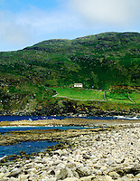 Rocky beach with hillside cottage, County Sligo, Ireland