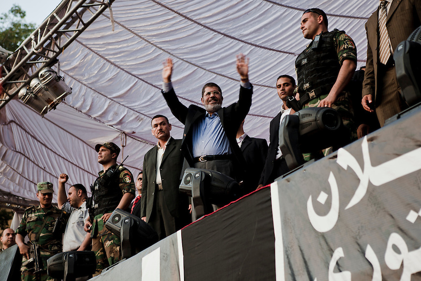 Egyptian President-elect Mohamed Morsi speaks on stage in Tahrir Square on June 29, 2012, in Cairo, Egypt. Accompanied by Egypt's 'Presidential Guard', Morsi made his first post-election appearance in Tahrir Square where he took a symbolic oath of office in front of supporters. Photo: Ed Giles.