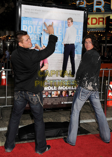 "MIKE MIZANIN (aka ""The Miz"") & GUEST.""Role Models"" Los Angeles Premiere at Mann's Village Theatre, Westwood, California, USA..October 22nd, 2008.full length jeans denim black suit jacket jeans denim arm in air hand gesture funny.CAP/ADM/BP.©Byron Purvis/AdMedia/Capital Pictures."