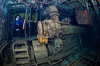 WJ3268-D. Scuba divers can easily and safely explore inside and outside the 184-foot-long Felipe Xicotancatl C-53 shipwreck. Here a woman (model released) swims through the engine room. Purposely sunk in 1999 in 75 feet of water just off the west side of Cozumel, this ship was originally named USS Scuffle and first served as a mine sweeper in the US Navy, and then later was sold to Mexico for use as a patrol and support vessel in the Mexican Navy. Cozumel, Mexico, Gulf of Mexico, Caribbean Sea.<br /> Photo Copyright © Brandon Cole. All rights reserved worldwide.  www.brandoncole.com