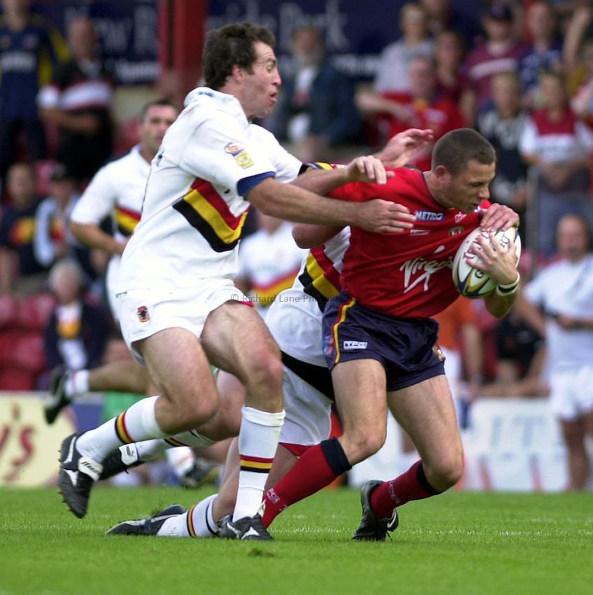Photo: Richard Lane..London Broncos v Bradford Bulls. Tetleys Super League. 31/08/2003..Bill Peden attacks.