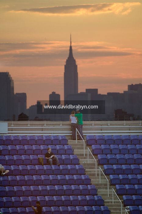 3 September 2005 - Flushing, NY - A couple looks out at the Manhattan skyline from the top of the Arthur Ash stadium at the National Tennis Center in Flushing, USA, 3 September 2005. Photo Credit: David Brabyn