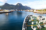 Hurtigruten ferry ship arriving at harbour at Svolvaer, Lofoten Islands, Nordland, Norway
