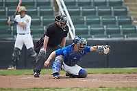 Mars Hill Lions catcher Austin Purser (37) frames a pitch as home plate umpire Grant Akins looks on during the game against the Queens Royals at Intimidators Stadium on March 30, 2019 in Kannapolis, North Carolina. The Royals defeated the Bulldogs 11-6 in game one of a double-header. (Brian Westerholt/Four Seam Images)
