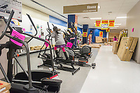 Children play on discounted fitness equipment at the soon to be closing Sears store in the New York borough of the Bronx on Sunday, October 26, 2014. Sears Holdings announced that it will close 77 Sears and Kmart stores prior to the Christmas holiday. This is in addition to previously announced closings and over 7000 jobs will be lost. (© Richard B. Levine)