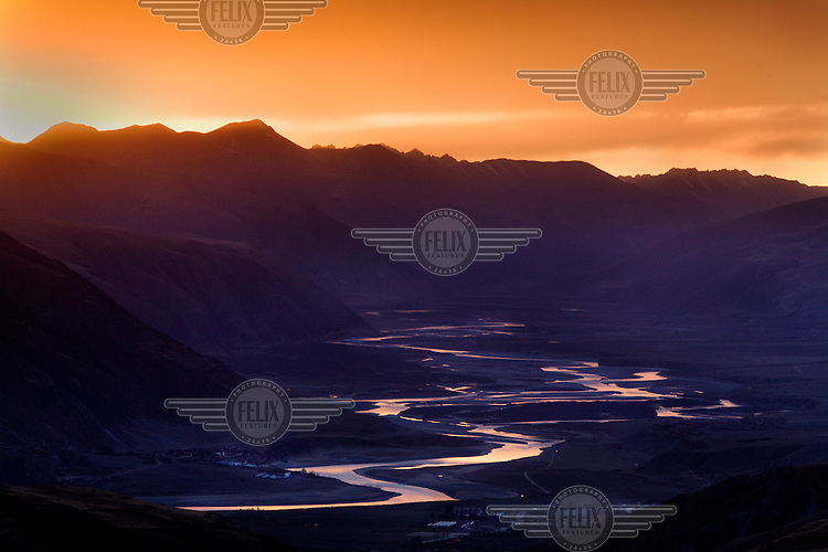 The Yangtze River meanders through a valley.