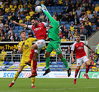 Oxford United's Scott Shearer claws the ball away from Fleetwood Town's Craig Morgan<br /> <br /> Photographer David Shipman/CameraSport<br /> <br /> The EFL Sky Bet League One - Oxford United v Fleetwood Town - Saturday August 11th 2018 - Kassam Stadium - Oxford<br /> <br /> World Copyright &copy; 2018 CameraSport. All rights reserved. 43 Linden Ave. Countesthorpe. Leicester. England. LE8 5PG - Tel: +44 (0) 116 277 4147 - admin@camerasport.com - www.camerasport.com