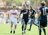 April 11, 2009: Ramiro Corrales of Earthquakes and Brian McBride of Fire in action during a game at Buck Shaw Stadium in Santa Clara, California. San Jose Earthquakes and Chicago Fire tied, 3-3