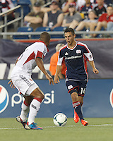 New England Revolution midfielder Diego Fagundez (14) dribbles. In a Major League Soccer (MLS) match, the New England Revolution (blue) tied D.C. United (white), 0-0, at Gillette Stadium on June 8, 2013.