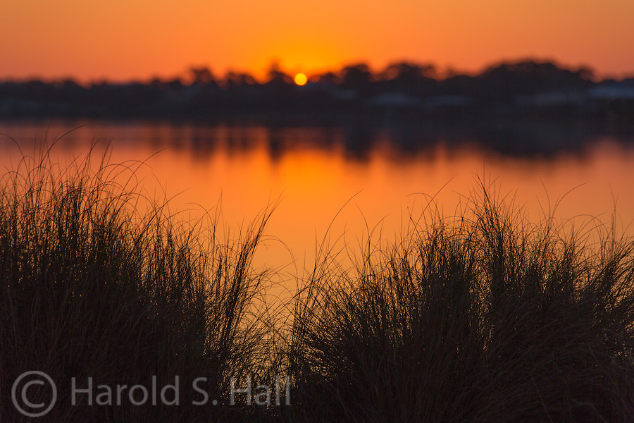 A sunrise among the grasses and back bay of Gulf Shores, Alabama.