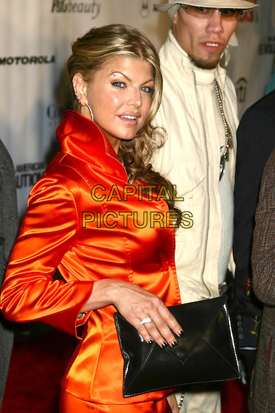 FERGIE - BLACK EYED PEAS.Conde' Nast Media Group Presents Fashion Rocks 2004   Radio City Music Hall in New York City..September 8, 2004 .half length, silk, satin orange top, black hand bag, purse.www.capitalpictures.com.sales@capitalpictures.com.© Capital Pictures