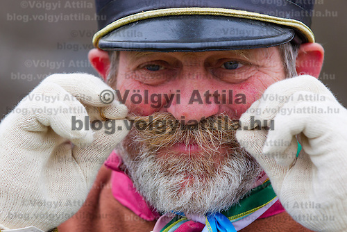 Man dressed as a Szekler captain adjusts his mustache during the re-enactment of the historic battle against Austrian soldiers of the Habsburg dynasty in Tapiobicske, 80 km (50 miles) southeast of Budapest, Hungary on April 04, 2013. ATTILA VOLGYI