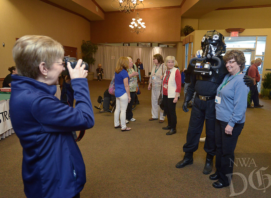 NWA Democrat-Gazette/BEN GOFF @NWABENGOFF<br /> Linda Mahoney (left) of Mountain Home takes a picture of Phyllis Hooker of Hollister, Mo. with a Star Wars imperial pilot from the 501st Legion on Saturday April 9, 2016 during the 29th annual Ozark Mountain UFO Conference at the Best Western Inn of the Ozarks in Eureka Springs.