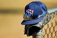 A Shippensburg Red Raiders hat sits on top of a glove on a fence at Newman Park on February 12, 2011 in Salisbury, North Carolina.  Photo by Brian Westerholt / Four Seam Images