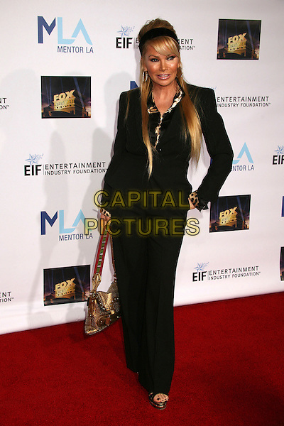 SUZAN HUGHES.Mentor LA's Promise Gala Honoring Tom Cruise at 20th Century Fox Studios, Century City, California, USA..March 22nd, 2007.full length black jacket bag purse gold hand on hip susan jacket  .CAP/ADM/BP.©Byron Purvis/AdMedia/Capital Pictures