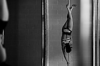 Valeria Aboultaif, a young Colombian pole dancer, hangs upside-down from a pole during a pole dance training session in Academia Pin Up in Medellín, Colombia, 2 March 2016. Pole dance, a performance combining sport with art and merging dance with acrobatics on a vertical pole, has reached wide popularity in Latin America in the last decade. With dance and physical attraction being a natural way of expression for many Latinas, thousands of women take pole dancing classes in gyms and dance studios, as a form of fitness and social entertainment.