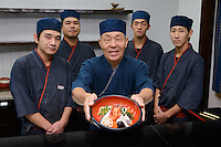 Yasuo Namba and staff of Kidoairaku sushi restaurant. Okayama, Okayama Prefecture, Japan, October 6, 2015. The southern city of Okayama is well-known for its temperate climate, castle, and the beautiful traditional Korakuen gardens.