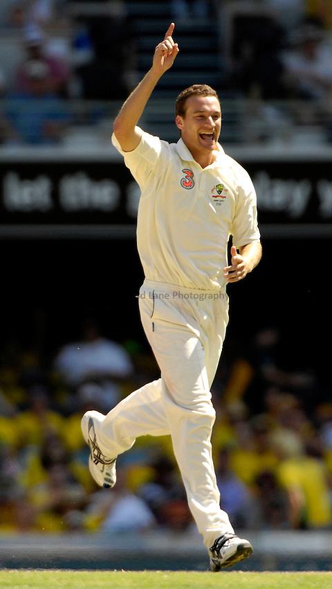 Photo: Steve Holland..Australia v England. 3 mobile Test Series, The Ashes 2006/07, 1st Test. 25/11/2006..Australia's Stuart Clark celebrates a wicket.