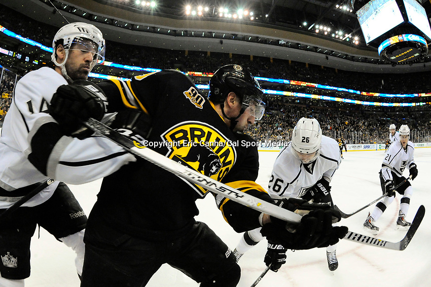 January 20, 2014 - Boston, Massachusetts, U.S. - Boston Bruins left wing Brad Marchand (63) and Los Angeles Kings right wing Justin Williams (14) battle for the puck at the boards during the NHL game between Los Angeles Kings and the Boston Bruins held at TD Garden in Boston Massachusetts. The Bruins defeated the Kings 3-2 in regulation time.   Eric Canha/CSM