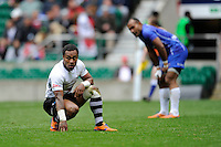 Benito Masilevu of Fiji and Faalemiga Selesele of Samoa look on during Day Two of the iRB Marriott London Sevens at Twickenham on Sunday 11th May 2014 (Photo by Rob Munro)
