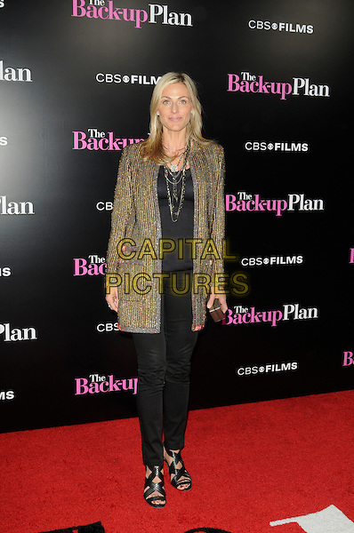 "JAMIE TISCH .arriving at the premiere of CBS Films' ""The Back-up Plan"" at the Regency Village Theatre in Westwood, California, USA, April 21st 2010..arrivals full length black jeans trousers green gold jacket sandals beaded .CAP/ROT.©Lee Roth/Capital Pictures"