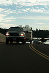 Black Ford F-250 Super Duty towing boat.
