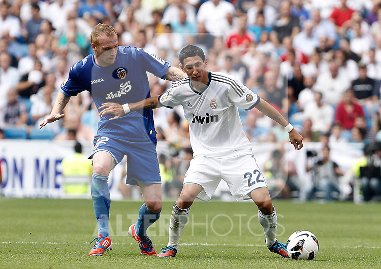 Real Madrid's Angel Di Maria (r) and Valencia's Jeremy Mathieu during La Liga match.August 19,2012. (ALTERPHOTOS/Acero)