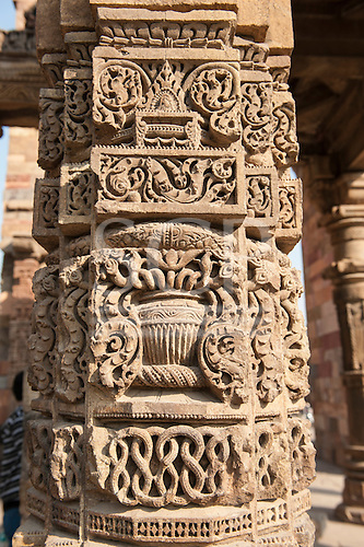 Delhi, India. Qutub Minar - Quwwat-ul-Islam Mosque. Decorative stonework on a pillar.