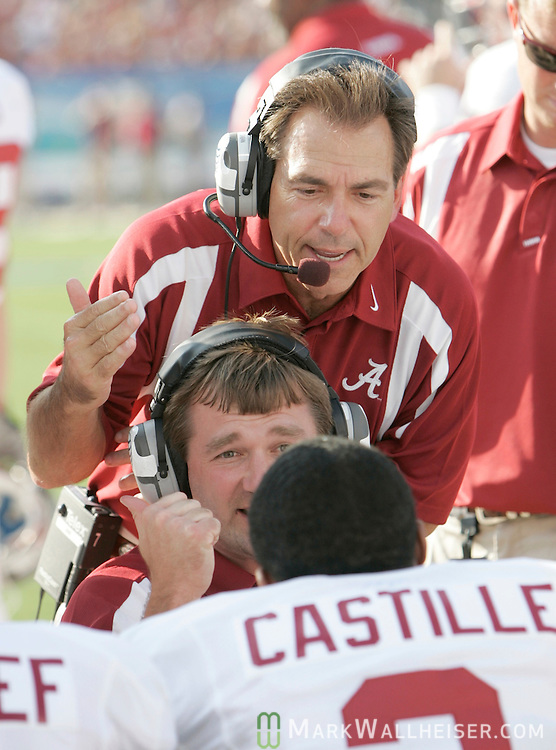 Alabama coach Nick Saban, top, and another coach talk to defensive back Simeon Casstille in the first half of their game against the Florida State Seminoles at Jacksonville Municipal Stadium in Jacksonville, Florida  September 29, 2007.    (Mark Wallheiser/TallahasseeStock.com)