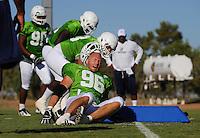 Sept. 16, 2009; Casa Grande, AZ, USA; California Redwoods defensive end (96) Paul Carrington loses his helmet while running drills during training camp at the Casa Grande Training Facility & Performance Institute. Mandatory Credit: Mark J. Rebilas-