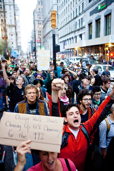 """Protesters with the """"Occupy Wall Street"""" movement gather by the thousands in the early morning of October 14, 2011 at Zuccotti Park in New York City.  Brookfield Properties, owners of the private park, had requested the NYPD's assistance in evacuating the park to facilitate a routine cleaning.  With protesters gathered en masse and a confrontation likely, Brookfield rescinded their request at the last minute.  Feeling victorious and emboldened, hundreds of protesters then proceeded to march along the streets of Wall Street and promptly found the confrontation that had been avoided by the Brookfield capitulation."""