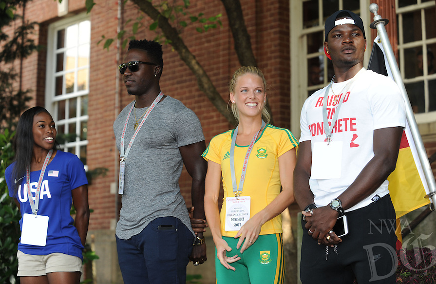 NWA Democrat-Gazette/ANDY SHUPE<br /> Olympians Chrishuna Williams (from left), Clive Pullen, Dominique Scott and Omar McLeod smile Thursday, July 28, 2016, as they gather together during a celebration for Razorbacks athletes who will be participating in the upcoming Olympics in Rio de Janeiro on the Fayetteville square. Seven current and former Arkansas track and field athletes who will represent the United States, Jamaica and South Africa were joined by several former Olympians with Arkansas ties.